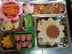 Flower PB, fruit leather flowers,  turkey dog tulips,  apple slices,  pumpkin seeds, goldfish crackers,  cheese daisy,  carrots,  pea pod leaves, and a mango candy