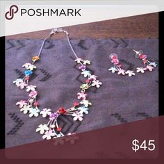 """Flower necklace Set ⚡️SALE ⚡️ Multi-color metal necklace on silver chain & matching earrings (pierced ears) with multiple colored stones . Necklace is 10.5"""" long total earrings are 2"""" from post to bottom a lovely piece. Jewelry Necklaces"""