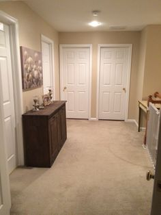 Sherwin Williams Kilim Beige: Pain Colors, hallway, neutral paint color, hallway decor, white trim, white doors