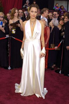 What: Marc Bouwer Where: Academy Awards in 2004 Why: Jolie offset her edgy persona with a surprisingly ethereal white satin gown and shawl.