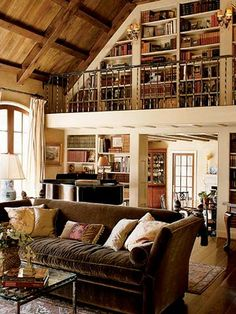 Now I know exactly where our new library will be. Our new home's living room area is set up almost like this, except with a fireplace under where the book are :-)