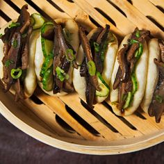 Fried shiitake mushrooms and hoisin sauce are stuffed into fluffy steamed buns in this vegan-friendly recipe from Momofuku Noodle Bar.