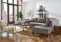 The Dune sectional was designed with small spaces in mind with slim, track arms. The focus is on neutral with a granite colored body fabric and soft yellow for the accent chair.