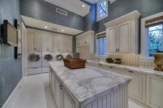 Traditional Laundry Room with Farmhouse Sink, Carrara White Marble Countertop, Crown molding, High ceiling Mudroom Laundry Room, Large Laundry Rooms, Laundry Room Design, Laundry Room Island, Laundry Storage, Garage Laundry, Laundry Baskets, Car Garage, Interior Exterior