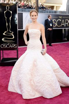 perfection. Jennifer Lawrence in Christian Dior Haute Couture with a Roger Vivier clutch