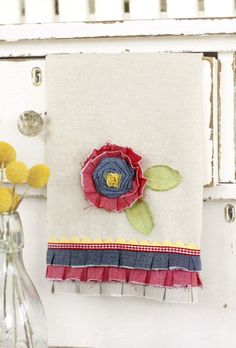 Flower with scrap materials and trim on a dish cloth
