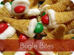 Holiday bites. Bugles, Chrismas colored M, White almond bark. Melt 1/4 pckg  almond bark at a time. After almond bark is melted, pick a bugle with a nice, wide opening. Dip the open end into the almond bark, top w an M Lay on wax paper to cool and harden.
