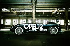 Side view of the Opel Rak 2 rocket car oldtimer in an old industrial building Stock Photo - 19275979