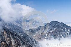 Mountain landscape on blue sky background