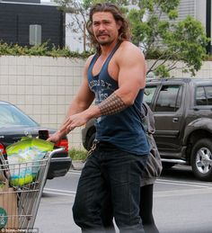 Muscling in: Jason Momoa left his very impressive biceps on show in Los Angeles on Thursda...