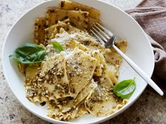 Broken Kerchiefs : For a variation on the Italian classic silk handkerchief pasta (made with large sheets of dough), break up lasagna noodles into squares before boiling. Toss with creamy pesto sauce, and include extra Parmesan and fresh basil leaves for serving.