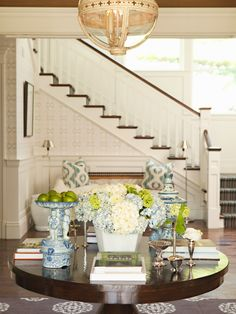 Like the staircase and the blue and green mix with the hydrangeas and silver on the table are wonderful!