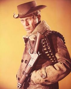 "Steve McQueen, the epitome of cool, played bounty hunter Josh Randall in Wanted: Dead or Alive...one of the great ""adult westerns"" of late fifties television.  His distinctive firearm was a sawed off .44-40 caliber Winchester Model 1892 rifle with a shortened stock which he carried in a holster on his hip like a sidearm.  #TV #classic #westerns"