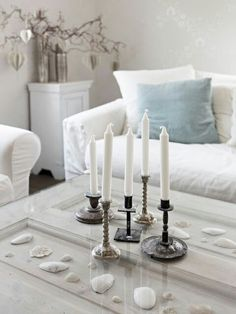 Looking at this pic gives me the idea to spay pint all of my candle sticks to match for a cute display.