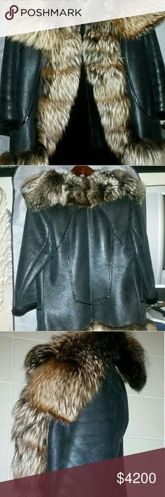 AMAZING METALLIC MERINO SHEARLING FOX FUR COAT ♡AMAZING♡ LUSH carbon black metallic Spanish Merino shearling stroller LENGTH gigantic THICK fox collar! This coat has too many details! Super soft metallic dyed lambskin leather accented with black patent leather. Interior fur is jet black. Sleeve length is 3/4 or longer. Hook & eye closure, but open is also fabulous too! Trimmed all over in plush fox fur! 2 interior pockets. This coat is MINT I PAID 5k+€ N ITALY PURE LUXE THE RIGHT PRICE takes…