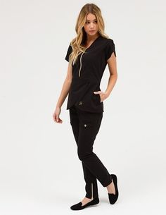 The Tulip Top in Black is a contemporary addition to women's medical scrub outfits. Shop Jaanuu for scrubs, lab coats and other medical apparel. Stylish Scrubs, Beautiful Nurse, Scrubs Outfit, Lab Coats, Medical Uniforms, Medical Scrubs, Scrub Tops, Work Attire, Black Tops