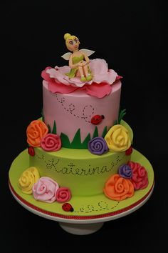 45- single tiered 6 inch with figurine standing flower.