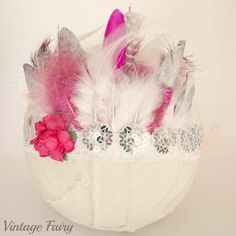 Loving our newest design, the gatsby feather crown. This crown is made using stunning sequin lace, lovely soft feathers and a small flower that sits to the side. Our crowns feature silver tipped feathers in amongst the mixture of feathers for that glitz look.Ties up in the back with ribbon Perfect accessory for a 1950's dress up party, a gatsby themed ocassion, a wedding or a photo shoot. Ties up in the back with ribbon Made to fit newborns to adults. please note the...