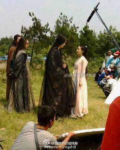 A behind the scenes photo of Sha Qian Mo with Hua Qian Gu.