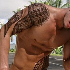 polynesian.tattoo on the upper arm.