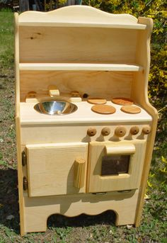 gorgeous little (locally made) wooden play kitchen. I love the shelving-- great place to store some little pots & pans.