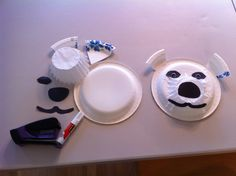 Polar Bear paper plate craft:  glue sticks, scissors, stapler, precut black construction paper eyes, nose and mouth, white paper plates (one for face, another to cut into eighths for ears), large white coffee filters and optional sticker googly eyes.  Glue nose to filter, flip filter over and glue around edge; attach to plate (filter should not be flat, but should stick up from plate.  Glue eyes, mouth and staple ears on.  Add googly eyes if desired.  Great for Arctic Animals lessons or Eric…