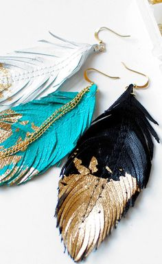 Gold dipped feather earings are tough and sweet. Perfect match for the #Hollister biker rally