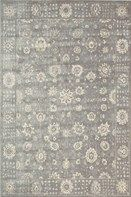 Scrolled floral designs dance and swirl through the center and border of this old world inspired area rug. Beautiful tones simultaneously call to mind the color palettes of antiquity and the progressive palettes of today. This rug is sure to breathe new life and a timeless sense of style into any room.