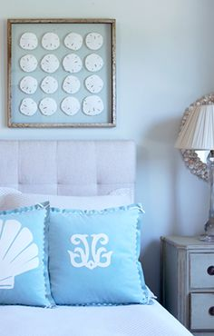 could DIY framed sand dollar art - would look great in a burlap wrapped shadow box...