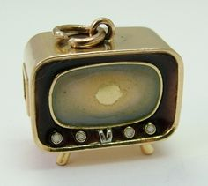 A large 1960's 18k 18ct gold television charm with enamel screen, surround and buttons.
