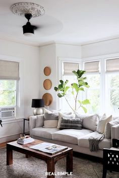 30 Easy and Chic Living Room Decorating Ideas for Any Sized Space | You can give your old home a modern facelift but still keep cool details. Here, Carli of Made By Carli updated an old-school ceiling medallion with a contemporary ceiling fan. Pairing two opposites ends up being a match made in heaven. #realsimple #livingroomdecor #livingroomideas #details #homedecorinspo Living Room Ceiling Fan, Chic Living Room, Cozy Living Rooms, Living Room Decor, Dining Room, Colourful Living Room, Curved Sofa, Eclectic Decor, Furniture Decor