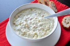 Thick And Creamy New England Clam Chowder Recipe -6 -7 pieces bacon, 1 medium onion, 2 (5 ounce) cans baby clams with juice reserved, 6 -7 potatoes, 2 (10 1/2 ounce) cans cream of celery soup, 1 cup heavy cream, 1 cup milk, 1 tablespoon butter, 1 teaspoon dried dill weed