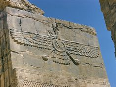 """Ahura Mazda, The """"flying sun disk."""" Also the Symbol for Mazda, you know the round disk with the bird in it?"""