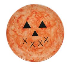 Creepy Crafts Countdown - Day 20. Pumpkin Plate. For this plate we colored the plate using orange alcohol ink and then once it was dry added the vinyl pumpkin face to the plate. This would be great hanging on the wall, or on a stand, or even to use on a table to serve (wrapped) Halloween treats.