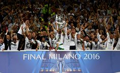 Sergio Ramos of Real Madrid of Real Madrid lifts the Champions League trophy after the UEFA Champions League Final match between Real Madrid and Club Atletico de Madrid at Stadio Giuseppe Meazza on May 28, 2016 in Milan, Italy. (May 27, 2016 - Source: Shaun Botterill/Getty Images Europe)
