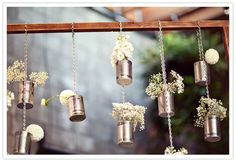 Love this idea for backdrop for the cake table but with glass jars rather than tin