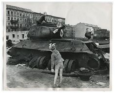 Children playing on T-34/85 wreck on the street of Berlin, May 1945