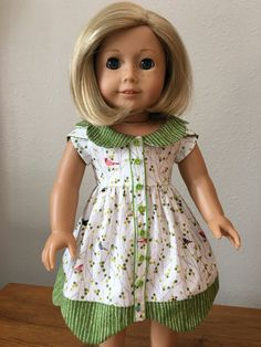 White and green scalloped dress by DressingDollsBoutiqu on Etsy. Made with the Bluebelle Dress pattern. Get it at http://www.pixiefaire.com/products/bluebelle-dress-18-doll-clothes. #pixiefaire #bluebelledress