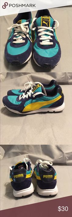 Size 6.5 Puma sneakers Size 6.5 super cute Pumas, navy suede with turquoise, white and yellow, minimal wear on the soles, excellent condition and gently used. Nike Shoes Sneakers