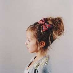 love the messy bun and big bow