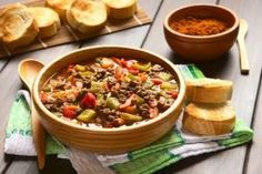 Stock photo Vegan goulash made of soy meat (textured vegetable protein), capsicum, tomato and onion, served in wooden bowl accompanied by toasted bread, photographed with natural light (Selective . Vegan Goulash, Soy Meat, Vegetable Protein, Quinoa, Chili, Soup, Gluten, Bread, Dishes
