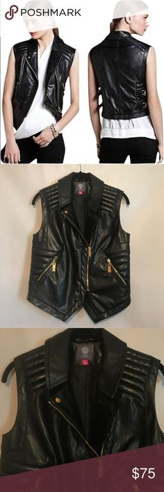 Vince Camuto Faux Leather Vest. Good pre-owned condition • Chic & edgy luxe faux leather vest with gold accents • Zip front with zip slant pockets • Quilted shoulders and sides • Buckle waist tabs • Dry clean only • Still has plastic on zippers • Ask all questions before purchasing • Length: 18-21 inches • Armpit to armpit: 17 inches • Size small. Vince Camuto Jackets & Coats Vests