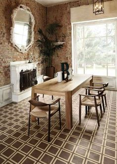 These warm earth tones in this #diningroom are beautiful. Bisazza's cement #tiles add a great #contemporary feel. Tile Names: Tobacco/ Tan Available at Tuo Sogno Tuosogno.com