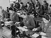 British enlisted women learning Morse code in classroom. Ca. 1942. World War 2. (BSLOC201410199) - Stock Photo