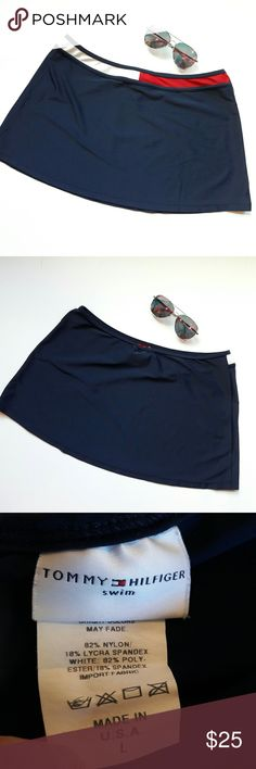 {Tommy Hilfiger} swim skirt Like New! This skirt you put over your bikini bottoms. Does not have bottoms attached underneath. This is just meant to be worn over as a cover up for bikini bottoms. Super cute! Very stretchy. Navy Blue, Red and white in color. From a smoke and pet free home. Fast shipping! Bundle and save even more. Tommy Hilfiger Swim