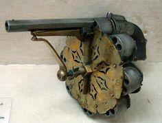 Joseph Enouy's 8-cylinder, 48-shot percussion revolver, dated 1855.