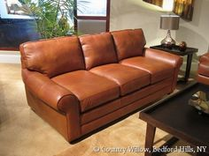 leather sofa with large round arms and deep seat- Country Willow Furniture