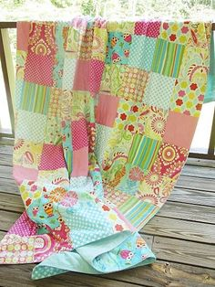 i would like to have 2 twin sized quilts made for my kiddos.  simple patchwork and fabrics/colors that they can grow up with.