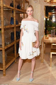 Kate Bosworth showed off her slender shape in a hippie chic off-the-shoulder dress at the Glamour Women To Watch Lunch hosted by Glamour editor-in-chief Cindi Leive at the Tory Burch Boutique in Beverly Hills on Friday