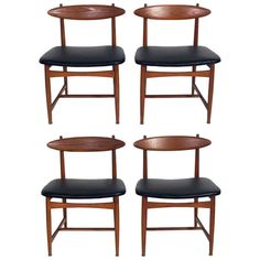 Set of Four Danish Modern Dining Chairs in the manner of Hans Wegner | From a unique collection of antique and modern dining room chairs at https://www.1stdibs.com/furniture/seating/dining-room-chairs/